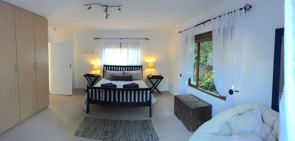Downstairs bedroom with double doors that open up directly onto spacious sundeck.