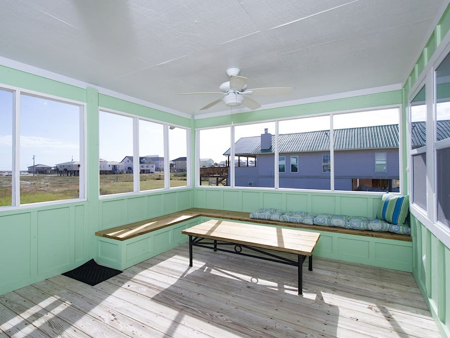 Enjoy fresh air and gulf views on the covered deck.
