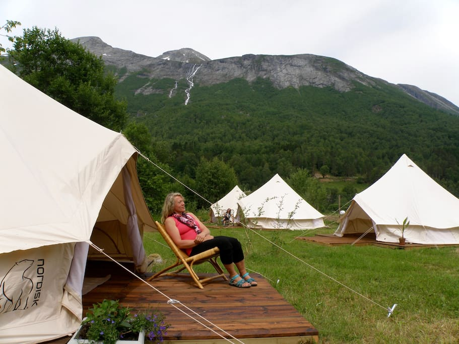 Relaxation at the tent camp surrendered by amazing mountains.