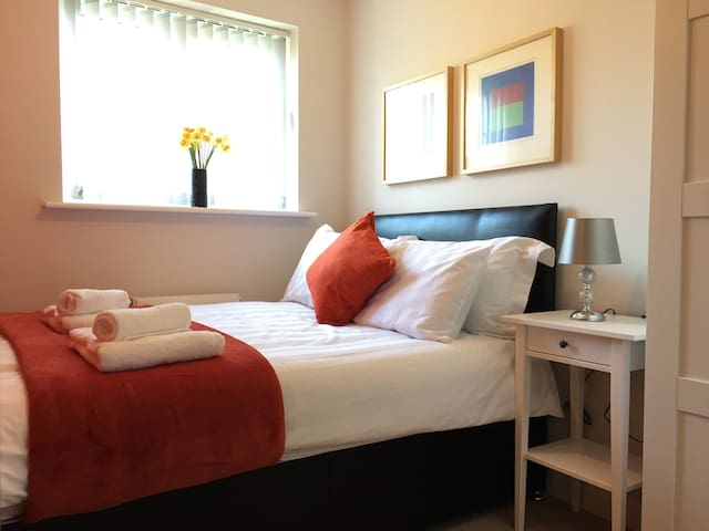 Bedroom 2 with small double bed, wardrobe, inbuilt drawers and mirror