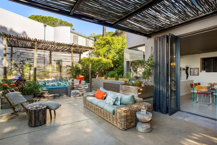 Outside area great for relaxing with big sliding doors leading to inside of the house.