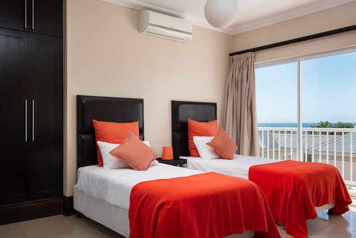 Twin beds with view to sea.