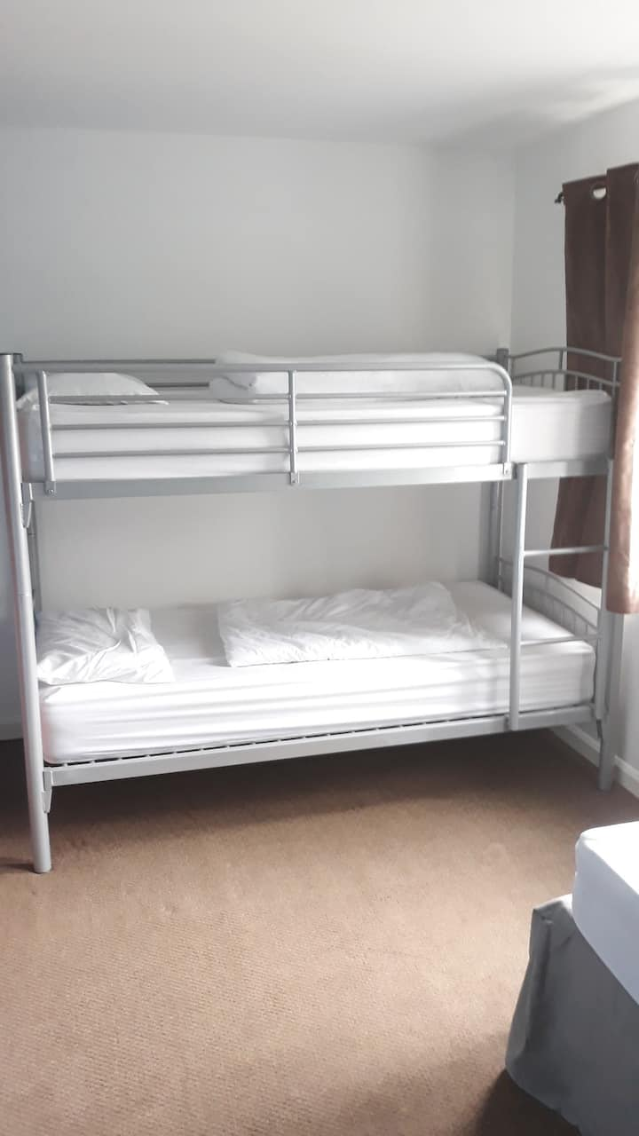 3 bed dorm. 1 bunk bed and 1 single bed.