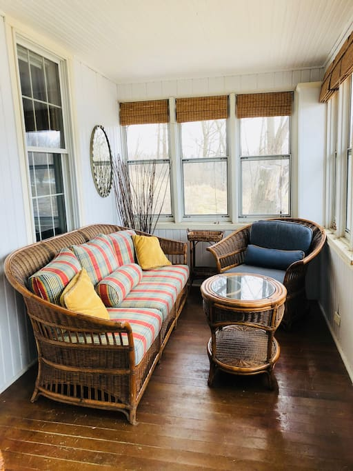 Relax and unwind on comfy wicker seating out on the front porch: catch a summer evening breeze, or sit sipping coffee in the warm morning sunshine.