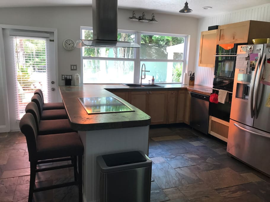 Chef's kitchen-stainless steal, top of the line appliances, breville toaster and juicer, French press, coffee machine, and Keurig machine.