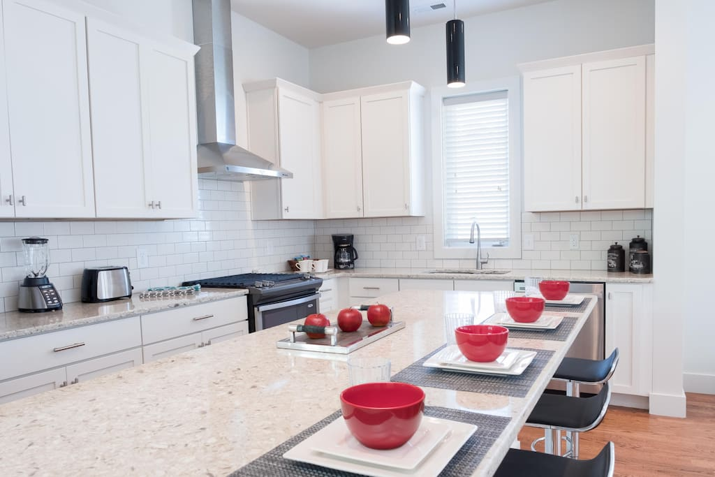 Breakfast bar and kitchen  Enjoy conversation with the cooks at the breakfast bar or watch your favorite Netflix program on the smart TV.  Stainless appliances including gas cooktop, French door refrigerator, undercounter microwave and dishwasher