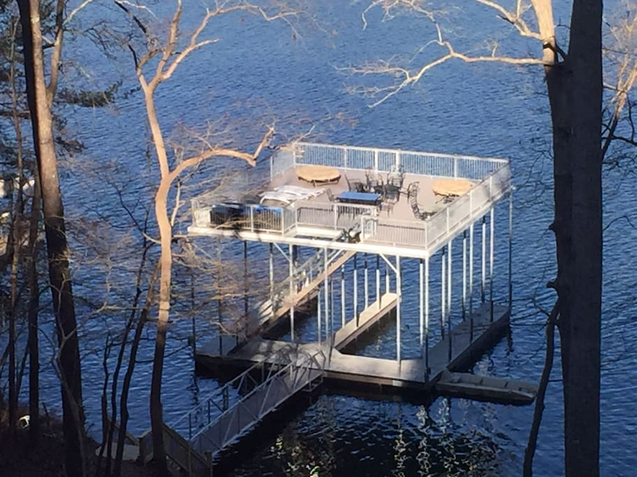 Brand new Resort style double slip high clearance dock. With 32 x 33 upper level sundeck.