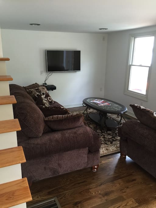 Furnished living room with basic cable and wi-fi.Views and slider to the private in-ground pool