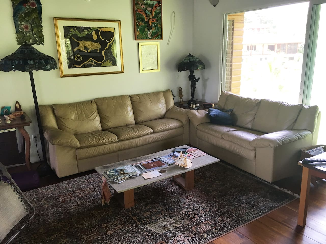 Living area, comfortable to relax and watch TV and open to screened in porch