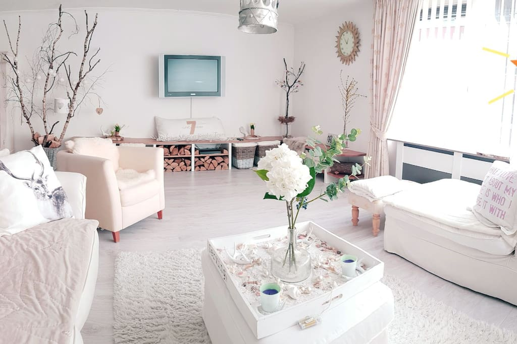 Large, sunny living room with open kitchen and dining table 65 sqm. Near the balcony.