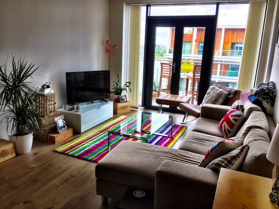 Open plan living room with access to the huge balcony and city views. TV complete with Netflix, Amazon Prime and catch up