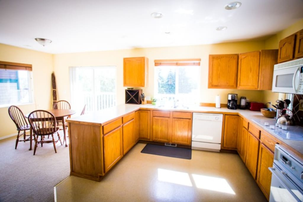 Kitchen - with sunlit dining area. Opens up to a private balcony.