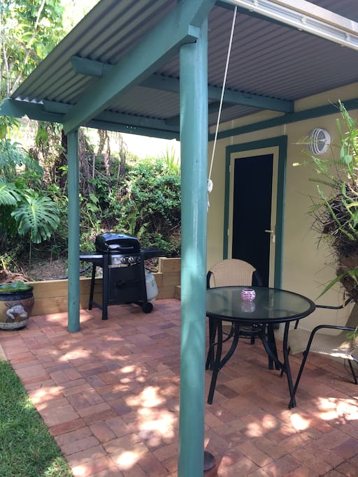 Outdoor paved area with gas bbq.