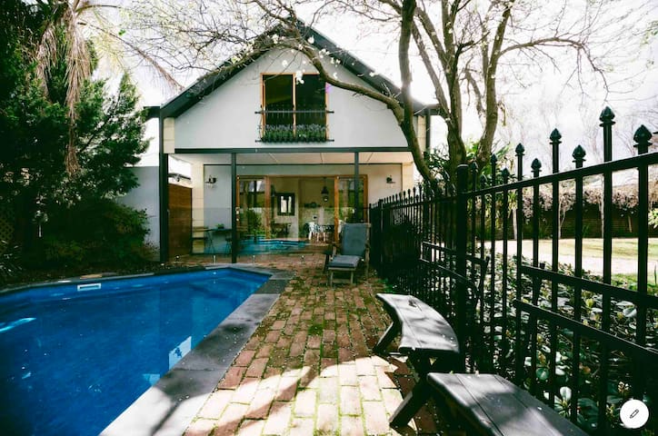 Direct access to the solar heated pool via French doors