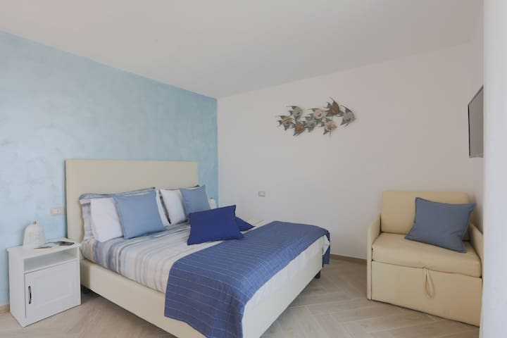 Queen Sized Bed and 1 Single Bed with Fresh Linens, Modern open wardrobe space and storage, Flat Screen TV, Direct access to the terrace with views of the Sea and Marina Grande, Air Conditioning, Free Wi-Fi 24hrs
