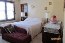 Master bedroom with queen size bed and complete with fainting couch!
