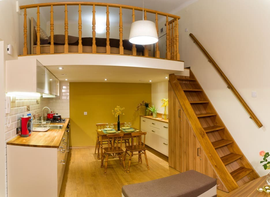 living room with the kitchen with view on the mezzanine