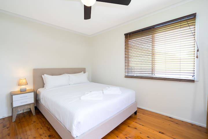 A bright second bedroom comes with queen bed, hotel quality linen, a bedside table and wardrobes for convenience