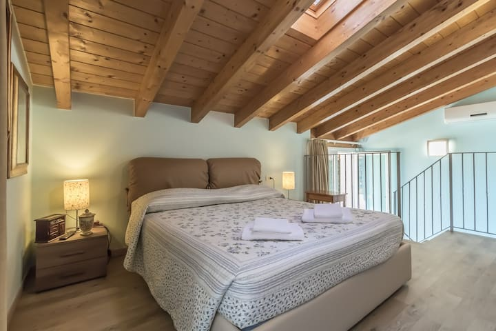Bedroom on the top floor with double bed.
