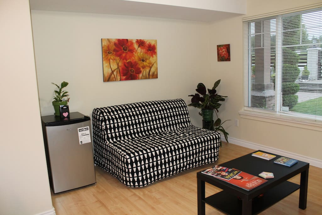 Savor your coffee and stare at the blossoms out in the garden or watch TV !   Sofa cum bed can accommodate one more person at an extra charge per night.