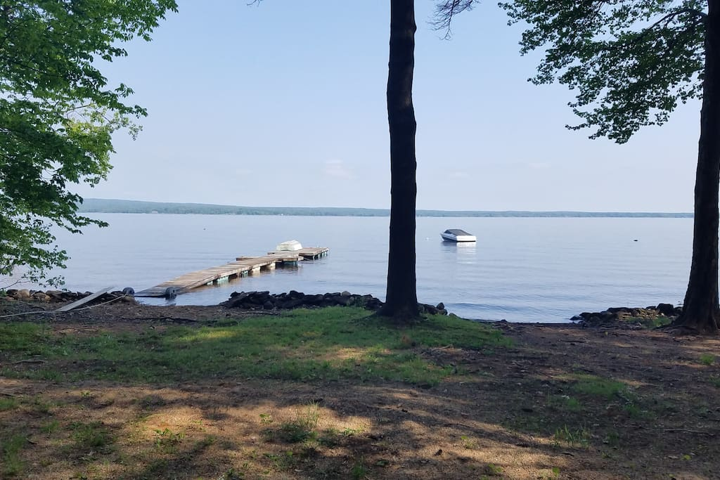 View of the lake and our dock from the beach.  Dock is 70' long and can hold a 22' boat.