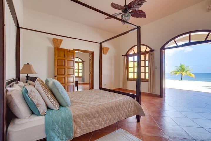 Downstairs suite 2 with queen bed and private bathroom. Adjoins Suite 3 if desired.