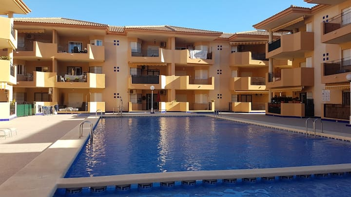 Spacious two bedroo apartment, communal pool open.