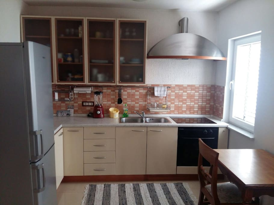Kitchen is equipped with all necessary for holiday stay.