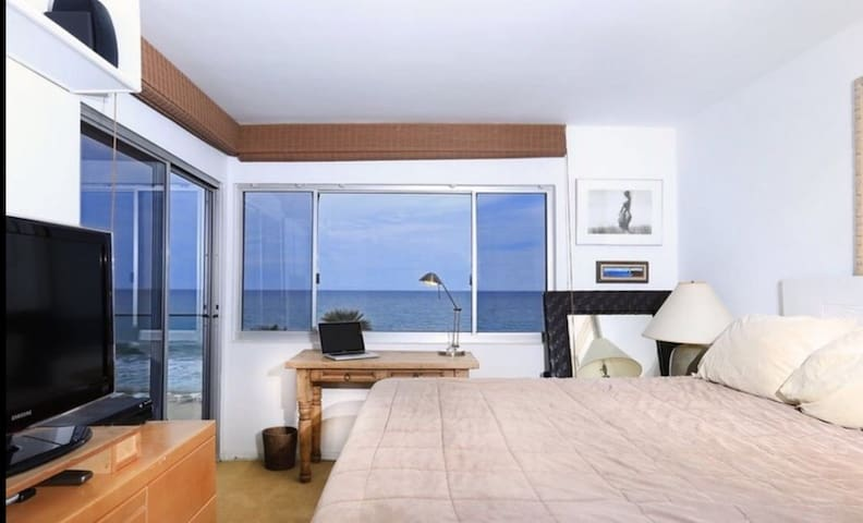 Master bedroom with stunning panoramic ocean views as well as additional access to the patio