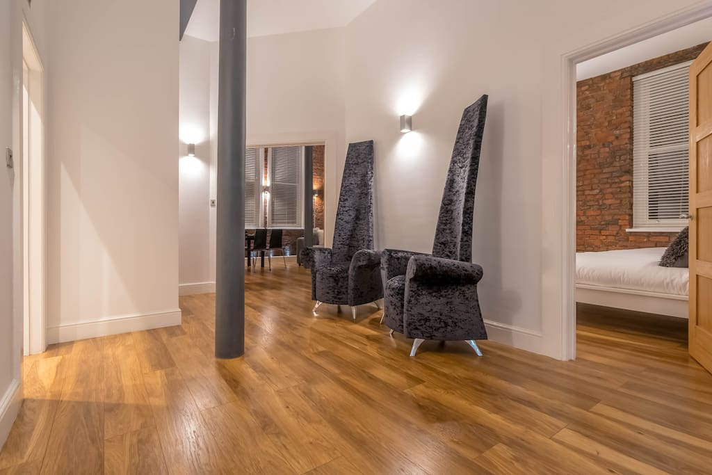 large hallway with seating area which adds to the feeling of space in the apartment