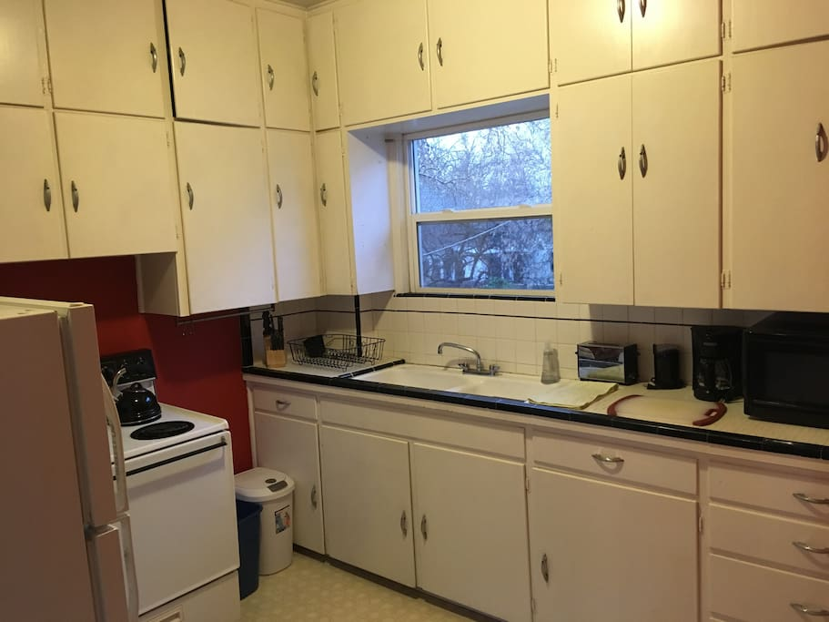 Fully stocked kitchen with microwave