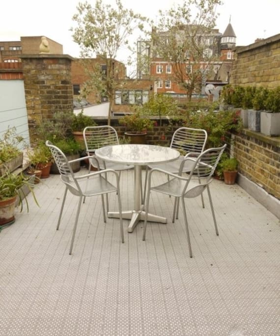 Roof terrace overlooking other converted Victorian industrial apartments etc