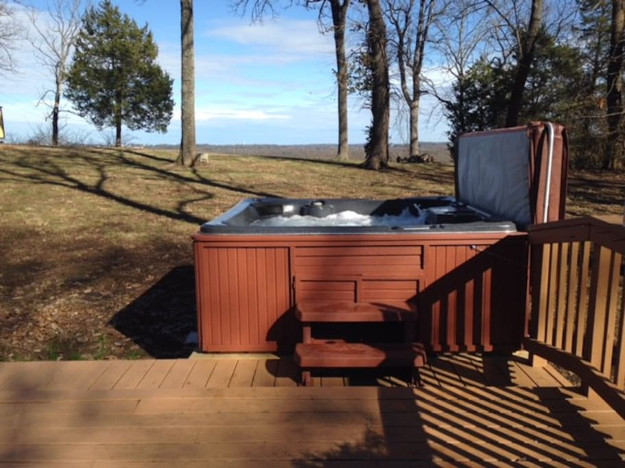 Hot Tub with Riverbank Backdrop