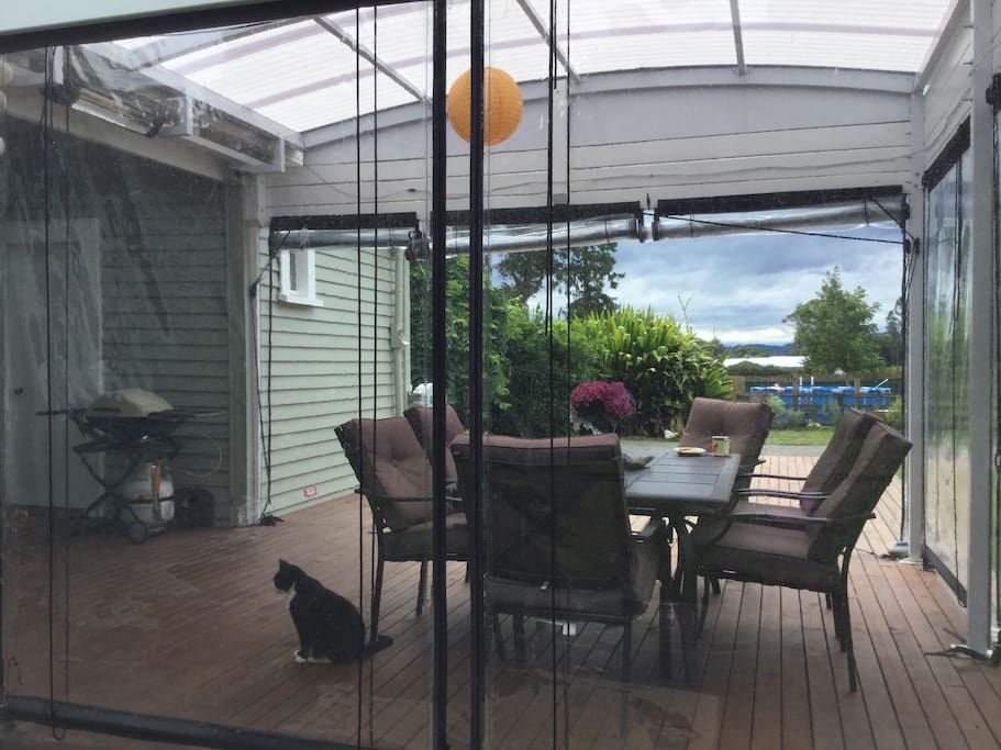 Covered deck with BBQ and view of the pool!