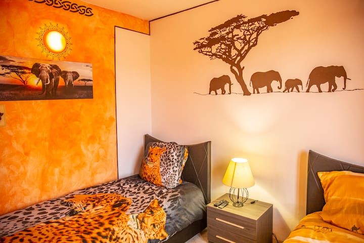 """""""Savannah"""" bedroom with 2 large single beds"""