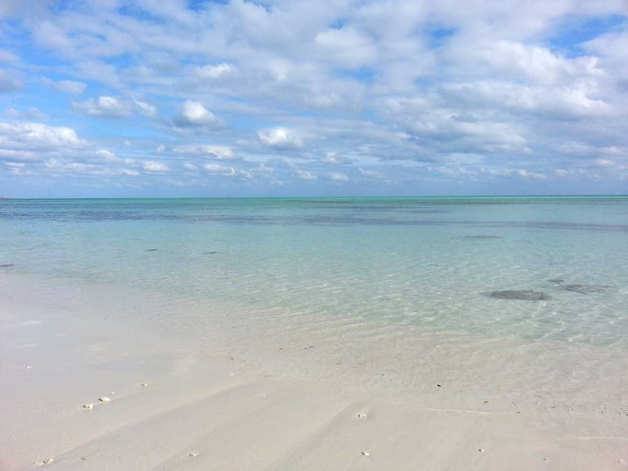 Gorgeous beach and tranquil turquoise waters just steps away.
