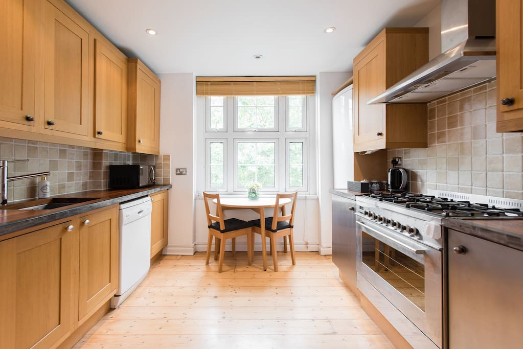 Separate kitchen with plenty of space to entertain, extendable dining to table.