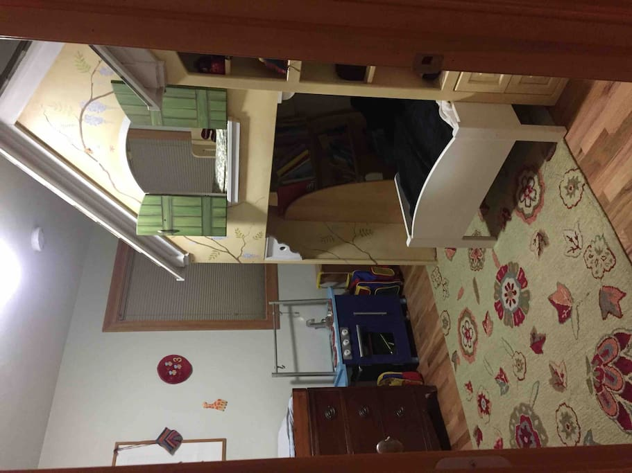 Kids room with loft and toddler bed
