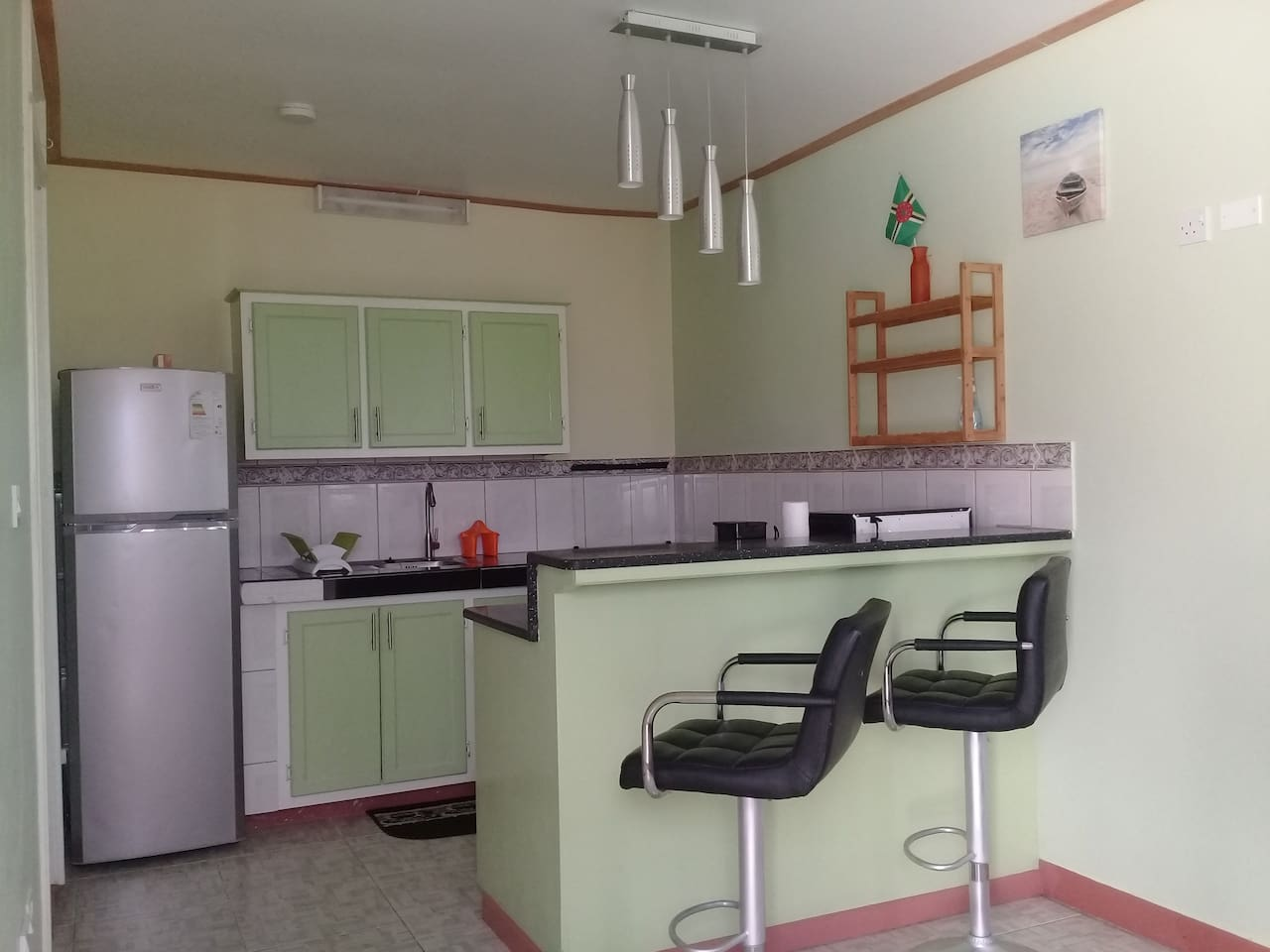 Enjoy your favourite meal in our well equipped  kitchen.  Windsor Apartment, a cozy ground floor apartment, is located in a quiet area in the community of Goodwill.  Enjoy the ambience of a peaceful environment minutes away from the capital city.