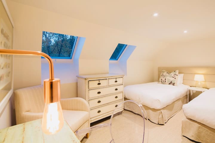 Bedroom five is a charming twin bedroom that can be set up as a super king