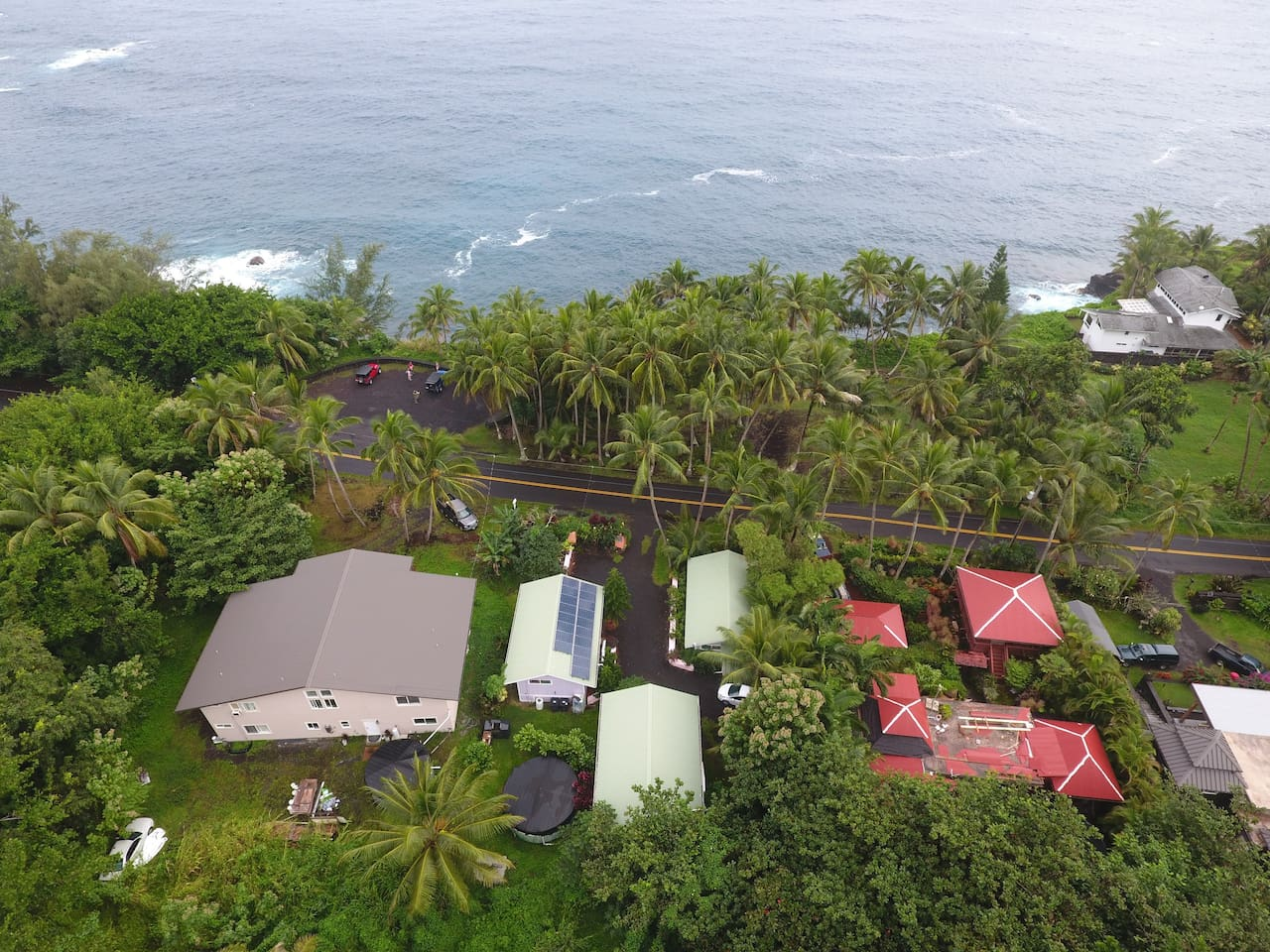 Aerial view of our 3 cottages: 1) Whale House (full kitchen) 2) Dolphin Cottage (food prep only) 3) Oceanfront Cottage (food prep only)