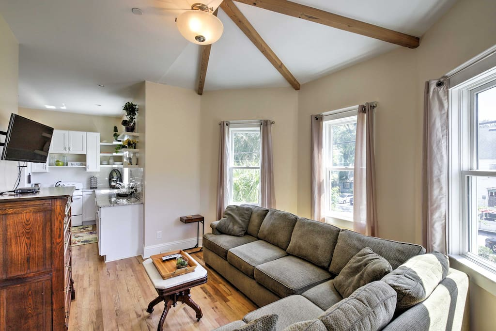 Sunshine pours in through the windows in the spacious living room.
