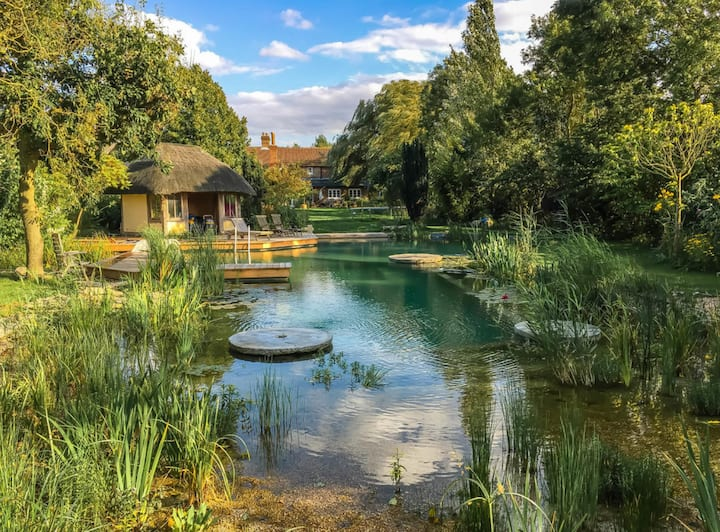 Glamping tents with natural pool & luxury hot tub
