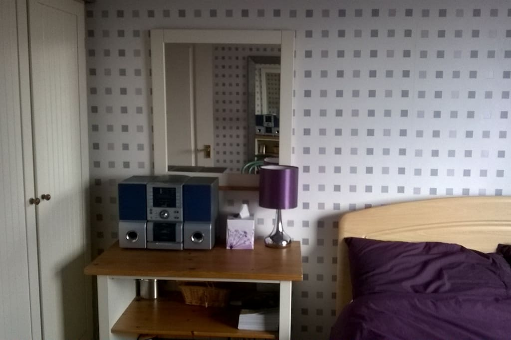 The room benefits from having a double wardrobe available and a reading lamp and music centre for guests use