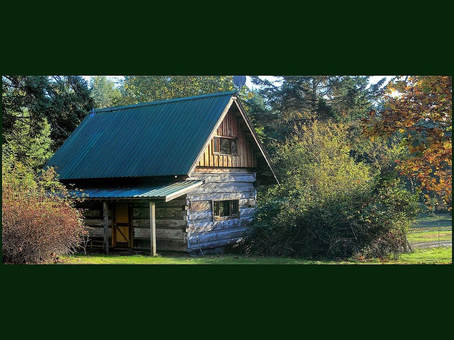 Galiano Island's Captain's Quarters 1894 Heritage Log House welcoming honeymooners and couples to a beautiful secluded southwest facing romantic getaway