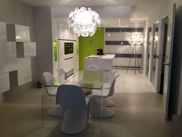 Living room, original Vitra chairs and crystal tables