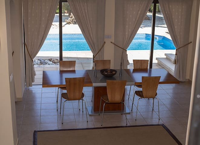 Dining area with pool views