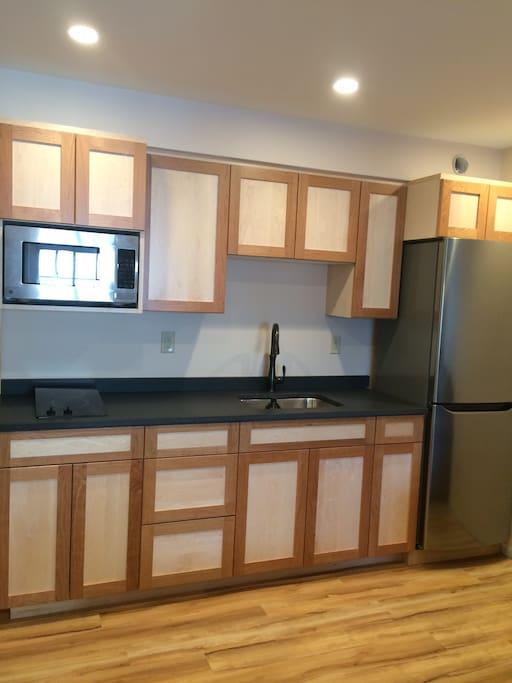 Kitchen with stove, fridge, dishes