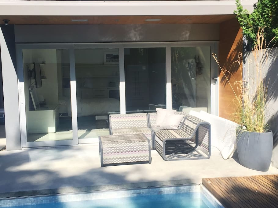 Modern Poolhouse, sun drenched mornings and tons of natural light and outdoor poolside lounging area