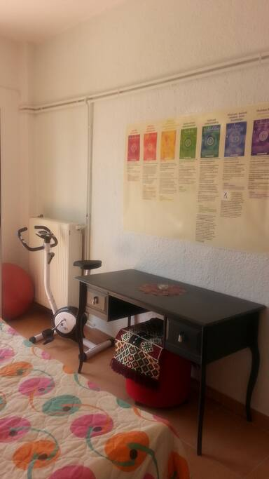 Next to the desk is also small fitness corner. You can bicycle, make exercise with a ball or yoga (on the wall is a poster with description).